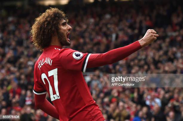 TOPSHOT Manchester United's Belgian midfielder Marouane Fellaini celebrates scoring the team's second goal during the English Premier League football...