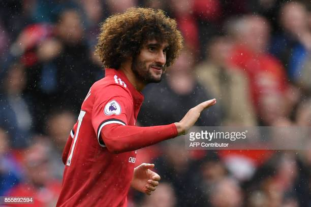 Manchester United's Belgian midfielder Marouane Fellaini celebrates with scoring his second and the team's third goal during the English Premier...