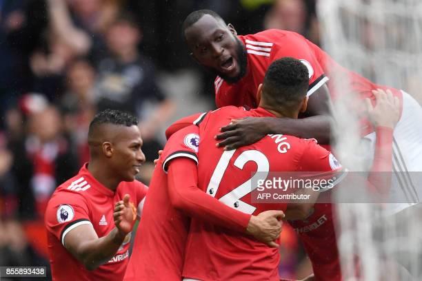 Manchester United's Belgian midfielder Marouane Fellaini celebrates with Manchester United's Belgian striker Romelu Lukaku and teammates scoring his...