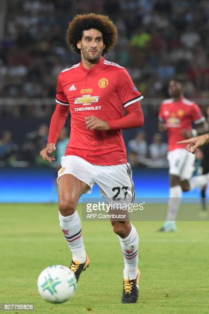 Manchester United's Belgian midfielder Marouane Fellaini drives the ball during the UEFA Super Cup football match between Real Madrid and Manchester...
