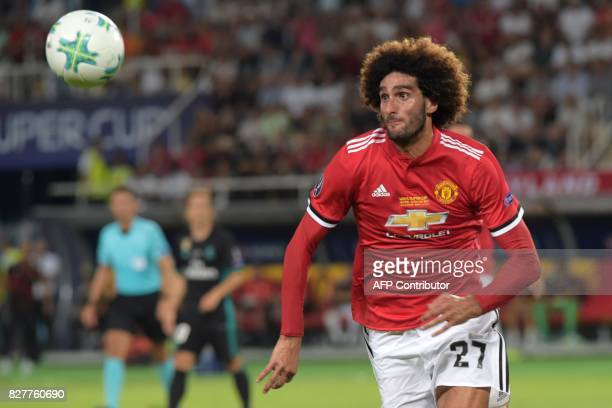 Manchester United's Belgian midfielder Marouane Fellaini eyes the ball during the UEFA Super Cup football match between Real Madrid and Manchester...