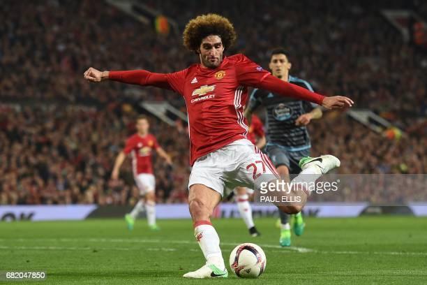 Manchester United's Belgian midfielder Marouane Fellaini has an unsuccessful shot during the UEFA Europa League semifinal secondleg football match...