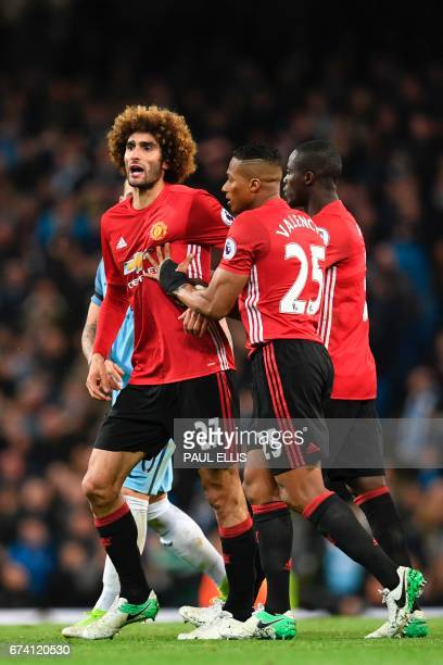 Manchester United's Belgian midfielder Marouane Fellaini reacts after being sent off after an altercation with Manchester City's Argentinian striker...