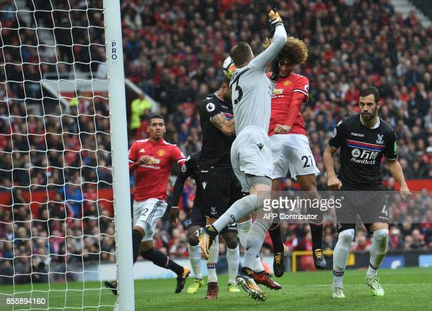 Manchester United's Belgian midfielder Marouane Fellaini scores his second and the team's third goal during the English Premier League football match...