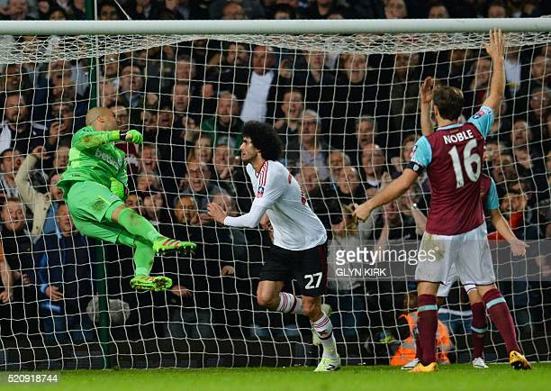 Manchester United's Belgian midfielder Marouane Fellaini scores past West Ham United's Irish goalkeeper Darren Randolph to make it 20 during the FA...