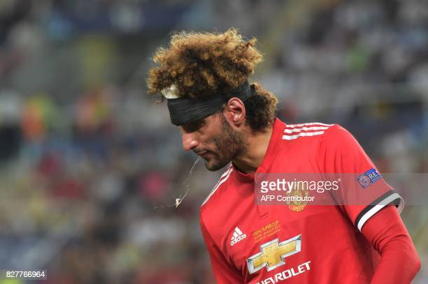 Manchester United's Belgian midfielder Marouane Fellaini spits during the UEFA Super Cup football match between Real Madrid and Manchester United on...
