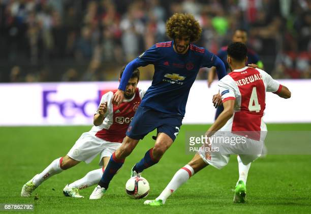 Manchester United's Belgian midfielder Marouane Fellaini vies for the ball with Ajax Dutch defender Jairo Riedewald during the UEFA Europa League...