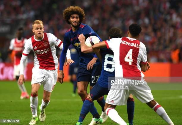 Manchester United's Belgian midfielder Marouane Fellaini vies with Ajax Dutch defender Jairo Riedewald during the UEFA Europa League final football...