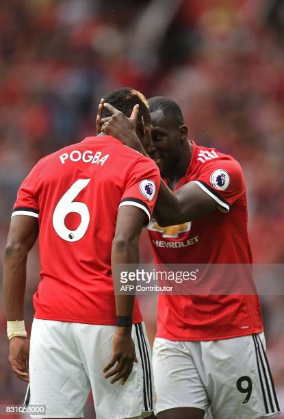Manchester United's Belgian striker Romelu Lukaku and Manchester United's French midfielder Paul Pogba celebrate Pogba's goal during the English...