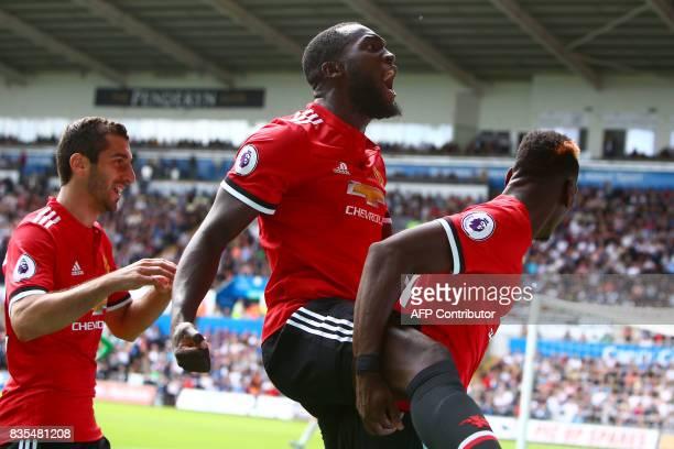 Manchester United's Belgian striker Romelu Lukaku and Manchester United's French midfielder Paul Pogba celebrate scoring the team's fourth goal...