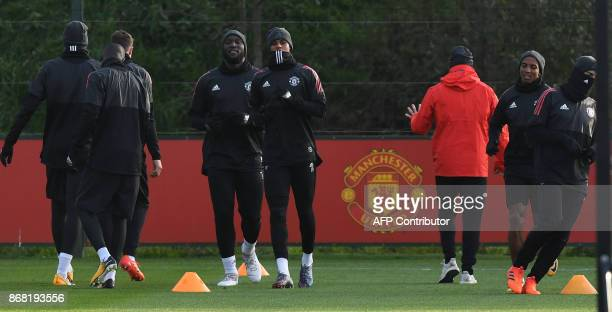 Manchester United's Belgian striker Romelu Lukaku and Manchester United's English striker Marcus Rashford attends a team training session at the...
