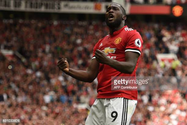 Manchester United's Belgian striker Romelu Lukaku celebrates scoring the opening goal during the English Premier League football match between...