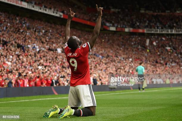 TOPSHOT Manchester United's Belgian striker Romelu Lukaku celebrates scoring the opening goal during the English Premier League football match...