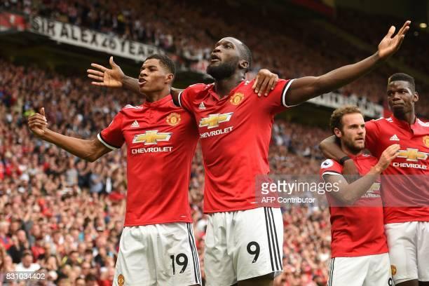 Manchester United's Belgian striker Romelu Lukaku celebrates scoring the opening goal with Manchester United's English striker Marcus Rashford during...