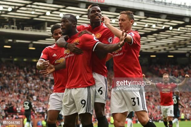 Manchester United's Belgian striker Romelu Lukaku celebrates scoring his team's second goal with Manchester United's English striker Marcus Rashford...