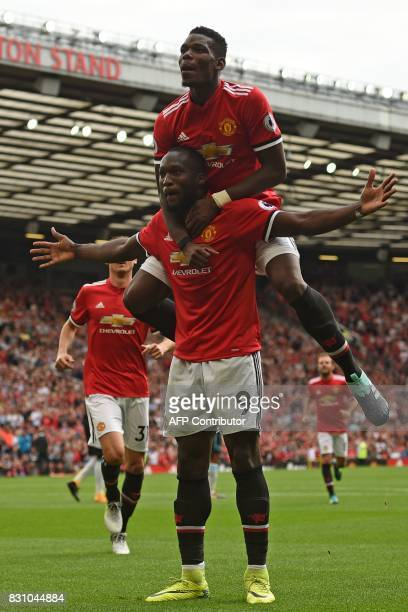 Manchester United's Belgian striker Romelu Lukaku celebrates scoring his team's second goal with Manchester United's French midfielder Paul Pogba...