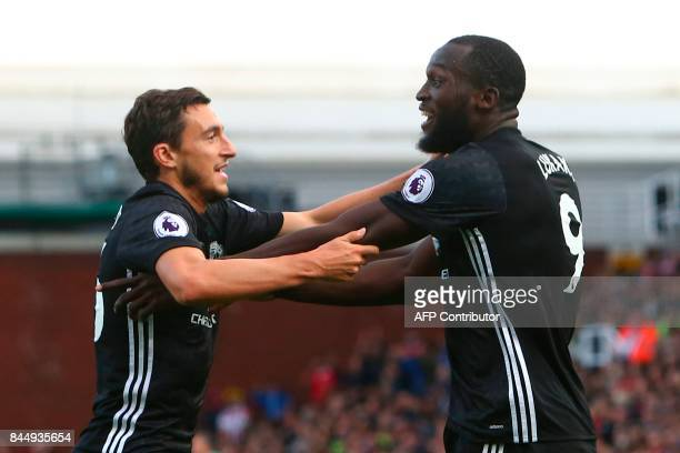 Manchester United's Belgian striker Romelu Lukaku celebrates scoring their second goal with teammate Manchester United's Italian defender Matteo...