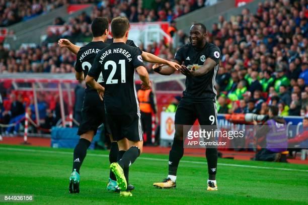 Manchester United's Belgian striker Romelu Lukaku celebrates scoring their second goal with teammates Manchester United's Italian defender Matteo...