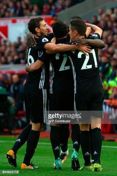 Manchester United's Belgian striker Romelu Lukaku celebrates scoring their second goal with teammates Manchester United's Spanish midfielder Ander...