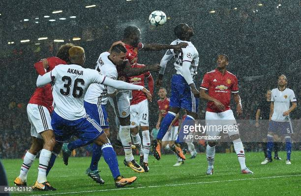 TOPSHOT Manchester United's Belgian striker Romelu Lukaku heads the ball to scores his team's second goal during the UEFA Champions League Group A...
