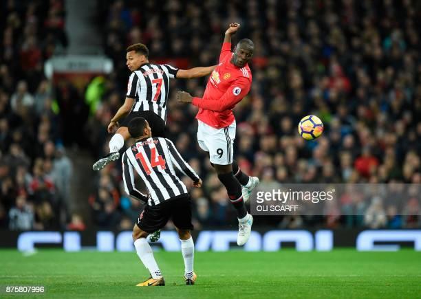 Manchester United's Belgian striker Romelu Lukaku jumps for the ball against Newcastle United's English midfielder Jacob Murphy during the English...