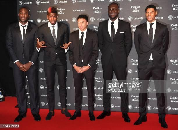 Manchester United's Belgian striker Romelu Lukaku Manchester United's French midfielder Paul Pogba Manchester United's English midfielder Jesse...