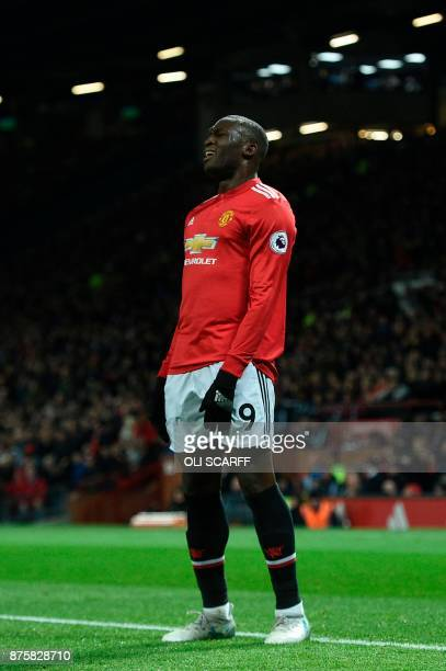 Manchester United's Belgian striker Romelu Lukaku reacts after a Manchester United's English striker Marcus Rashford missed a chance during the...