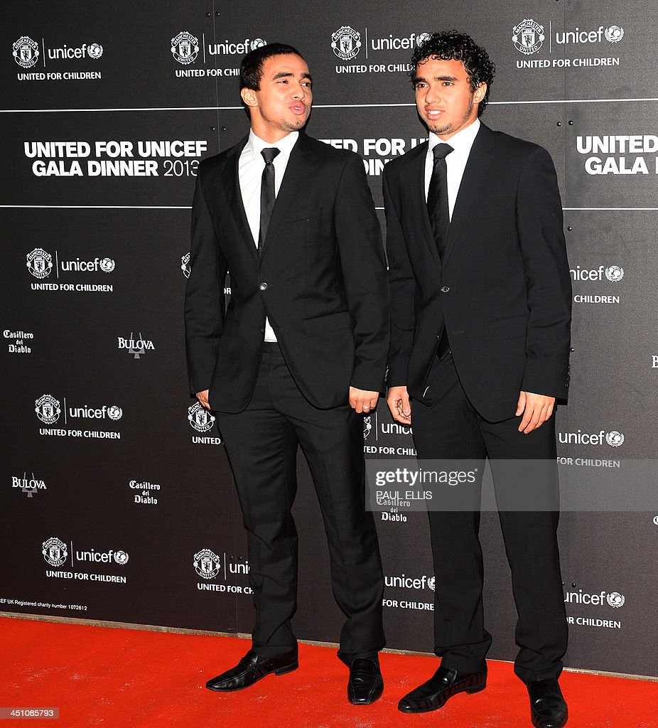 Manchester United's Brazilian defender Fabio Da Silva (L) and Manchester United's Brazilian defender Rafael Da Silva pose for photographs as they arrive for a gala dinner in aid of UNICEF at Old Trafford in Manchester on November 21, 2013.