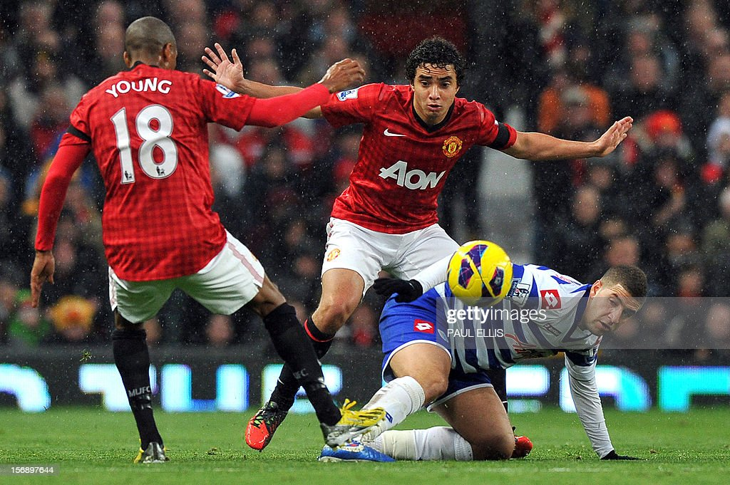 "Manchester United's Brazilian defender Rafael (C) and English forward Ashley Young (L) challenge QPR's Adel Taarabt during the English Premier League football match between Manchester United and Queens Park Rangers at Old Trafford in Manchester, north-west England, on November 24, 2012. AFP PHOTO/PAUL ELLIS- USE. No use with unauthorized audio, video, data, fixture lists, club/league logos or ""live"" services. Online in-match use limited to 45 images, no video emulation. No use in betting, games or single club/league/player publications"