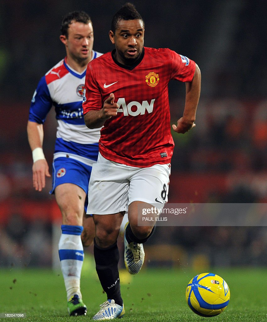 "Manchester United's Brazilian midfielder Anderson runs with the ball during the English FA Cup fifth round football match between Manchester United and Reading at Old Trafford in Manchester, north west England, on February 18, 2013. USE. No use with unauthorized audio, video, data, fixture lists, club/league logos or ""live"" services. Online in-match use limited to 45 images, no video emulation. No use in betting, games or single club/league/player publications."