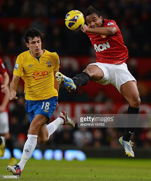 Manchester United's Brazilian midfielder Anderson vies with Southampton's English midfielder Jack Cork during the English Premier League football...