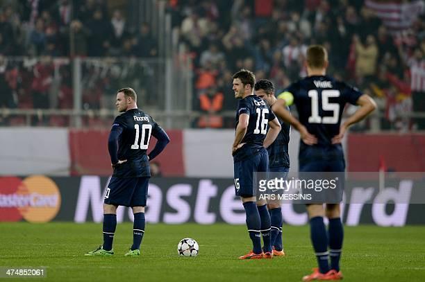 Manchester United's British forward Wayne Rooney and British midfielder Michael Carrick Dutch forward Robin van Persie and Serbian defender Nemanja...
