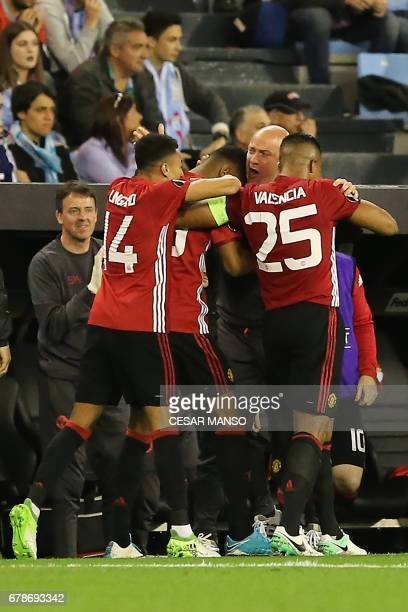 Manchester United's celebrate their opener during their UEFA Europa League semi final first leg football match RC Celta de Vigo vs Manchester United...