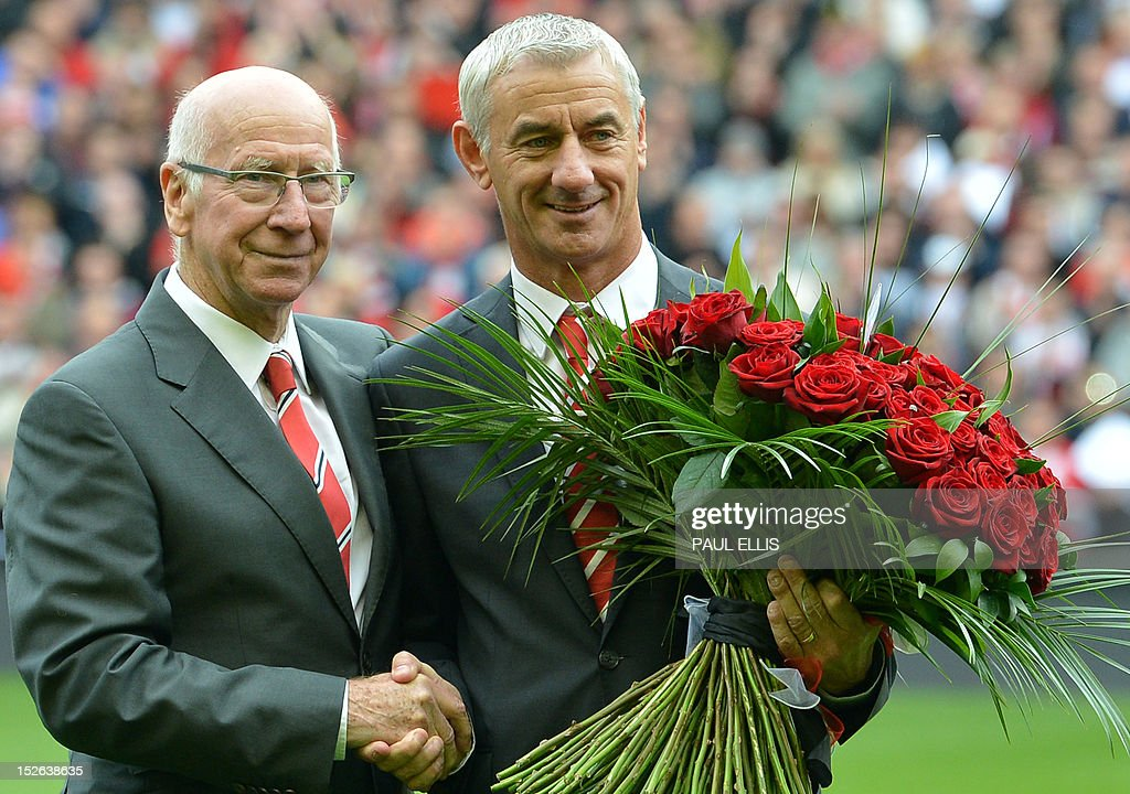 "Manchester United's club ambassador Bobby Charlton (L) hands a bouquet of 96 roses to Liverpool's club ambassador Ian Rush (R) before the English Premier League football match between Liverpool and Manchester United at Anfield in Liverpool, north-west England on September 23, 2012. The 96 roses represent the 96 supporters who died in the 1989 Hillsborough disaster.AFP PHOTO/PAUL ELLIS USE. No use with unauthorized audio, video, data, fixture lists, club/league logos or ""live"" services. Online in-match use limited to 45 images, no video emulation. No use in betting, games or single club/league/player publications."