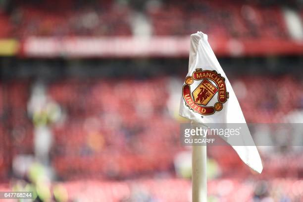 Manchester United's club crest is pictured on a corner flag ahead of the English Premier League football match between Manchester United and...