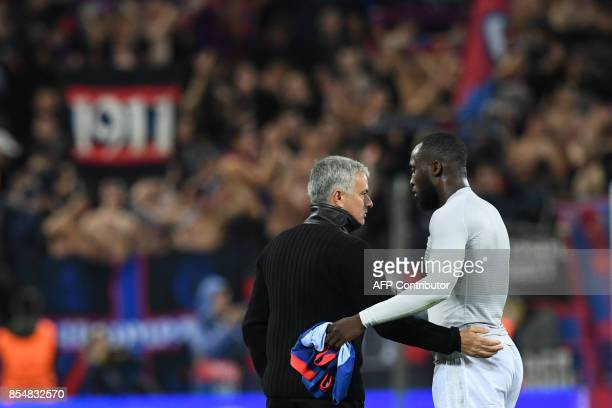 Manchester United's coach from Portugal Jose Mourinho thanks Manchester United's forward from Belgium Romelu Lukaku after the UEFA Champions League...