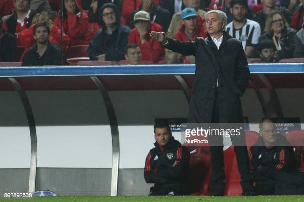 Manchester United's coach Jose Mourinho gestures from the sideline during the Champions League football match between SL Benfica and Manchester...
