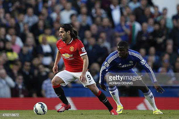 Manchester United's Colombian striker Radamel Falcao turns with the ball tracked by Chelsea's French defender Kurt Zouma during the English Premier...