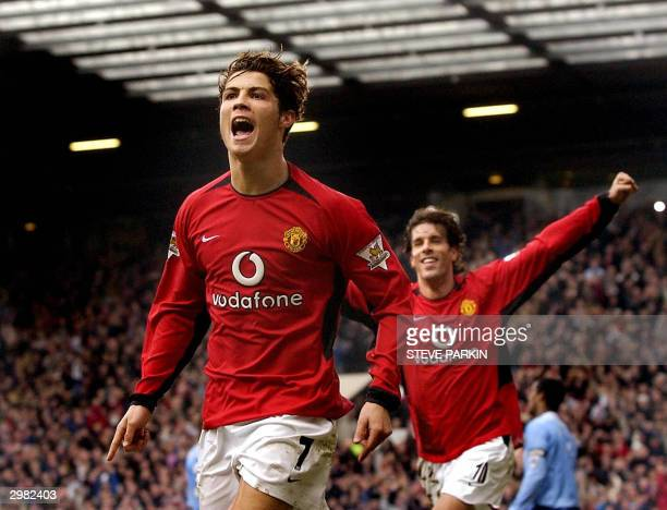 Manchester United's Cristian Ronaldo celebrates after scoring his team's third goal as teammate Ruud Van Nistelrooy runs in 14 February 2004 in...