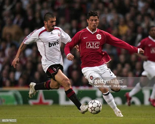 Manchester United's Cristiano Ronaldo and AC Milan's Gennaro Gattuso battle for the ball