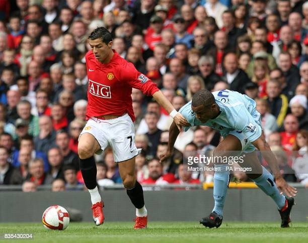 Manchester United's Cristiano Ronaldo and Manchester City's Vincent Kompany battle for the ball