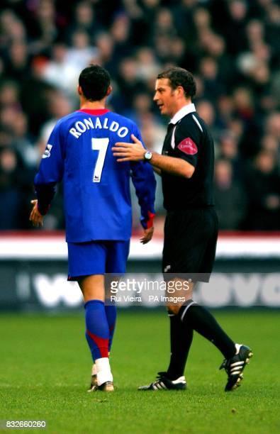 Manchester United's Cristiano Ronaldo and Mark Clattenburg