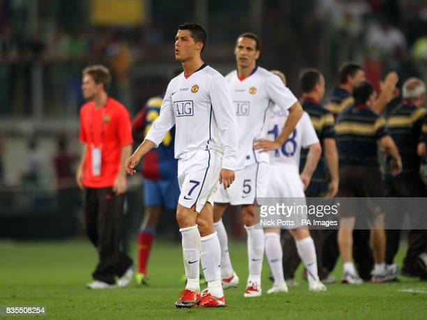 Manchester United's Cristiano Ronaldo and Rio Ferdiand stand dejected after the final whistle