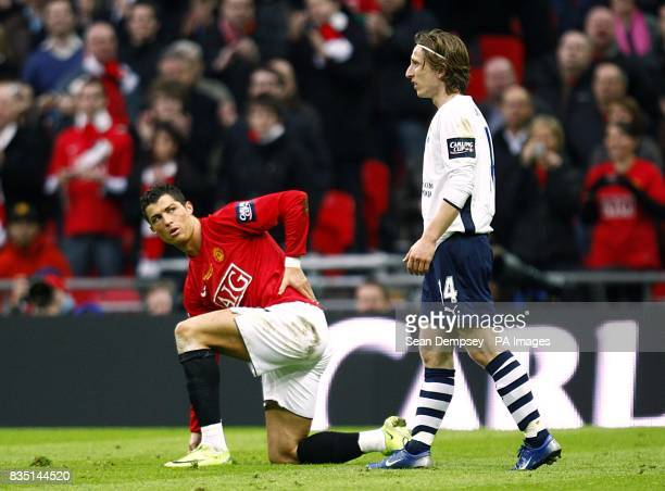 Manchester United's Cristiano Ronaldo and Tottenham Hotspur's Luka Modric battle for the ball
