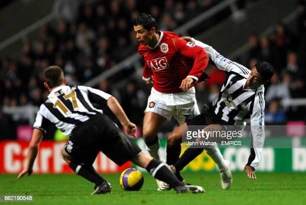 Manchester United's Cristiano Ronaldo battles for the ball with Newcastle United's Scott Parker and Nolberto Solano