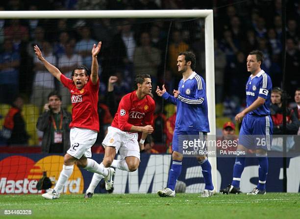 Manchester United's Cristiano Ronaldo celebrates scoring his sides first goal of the game as Chelsea's John Terry and Ricardo Carvalho stand dejected