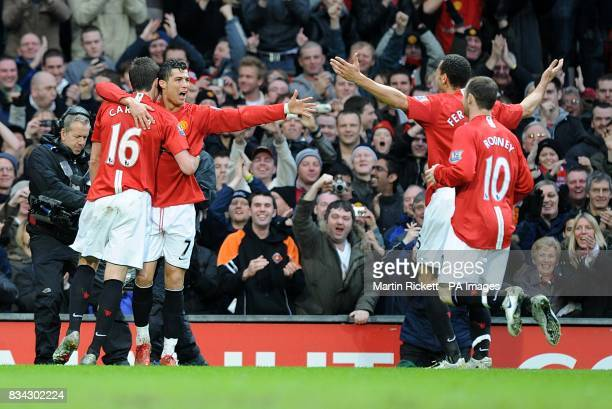 Manchester United's Cristiano Ronaldo celebrates scoring the opening goal of the game with team mates