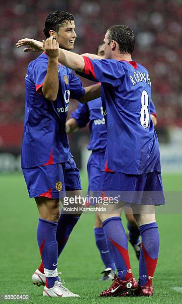 Manchester United's Cristiano Ronaldo celebrates Wayne Rooney's second goal during the preseason friendly match against Urawa Reds at Saitama Stadium...