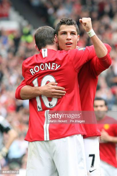 Manchester United's Cristiano Ronaldo celebrates with team mate Wayne Rooney after scoring the 3rd goal