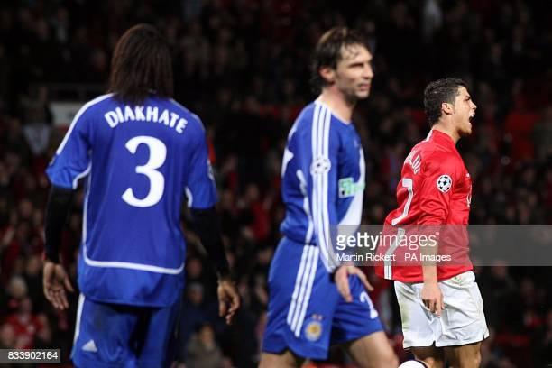 Manchester United's Cristiano Ronaldo celebrtes scoring his sides fourth goal of the game as Dynamo Kiev's Pape Malickou Diakhate and Vladislav...